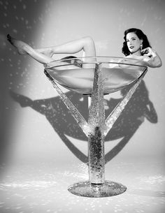 Dita Von Teese-Don't know who she is but I wish I was in her shoes...er I mean in her glass....lol!