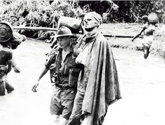 the Salamaua–Lae campaign in New Guinea Sergeant Gordon Ayre assists Private William Johnson, wounded by a Japanese grenade, to an advanced. Terra Australis, William Johnson, Australian Photography, Australian Defence Force, War Photography, A Moment In Time, Iconic Photos, Historical Pictures, World War I