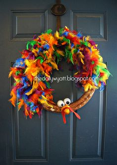 less then 10 minutes dyi turkey wreath/like this but with orange, yellow, brown, and tan feathers