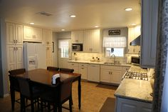 Traditional Raised Panel Kitchen Remodel Cream Cabinets With White Spring Granite Counter Tops Wood