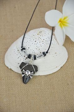 Megalodon Shark Tooth Necklace with Silver Skull by JustBeadHappy2 on Etsy https://www.etsy.com/listing/235720901/megalodon-shark-tooth-necklace-with