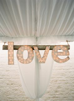 LOVE Wedding #Sign | See the wedding on #SMP: http://www.stylemepretty.com/2013/12/12/traditional-charleston-wedding Photography - KT Merry