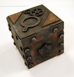 This is what we think the cursed box should look like. It has a mysterious history and no one can remember where it came from. It sometimes pulses with green time energy (ala Time Warp Trio) as it holds a paradox and was made by a member of the race of the netherworld (Scils).