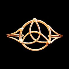 Our hand made bronze Celtic Knot bracelet, or Triquetra is 6 and adjustable for wear on most wrists. The bracelet is approximately wide at its widest point and coated in a clear lacquer to preserve the finish. Celtic Bracelet, Triquetra, Wire Art, Celtic Knot, Artisan Jewelry, Witches, Jewelry Ideas, Knots, Bronze