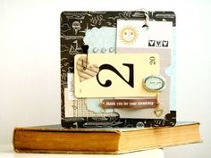 Anniversary card. A combination of Basic Grey, 7Gypsies, Cosmo Cricket and snippets of old book pages. by Julie Kirk