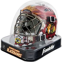 FRANKLIN SPORTS NHL CHICAGO BLACKHAWKS MINI GOALIE MASK  https://allstarsportsfan.com/product/franklin-sports-nhl-chicago-blackhawks-mini-goalie-mask/  Miniature goalie mask. Decorated with NHL team logos and colors. Reusable clear display box. Officially licensed. Approximate Dimensions: W 4.5″ x L 5″ x H 4″. Model: 7784F. Made in China.