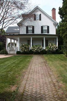 Brick path to a gorgeous old farmhouse