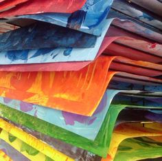 Once the painted paper is dry, I use a cutter to cut all the paper in half. This makes the pieces easier to manage and it gives me an opportunity to sort into colors. I place stacks of similar colors into trays (I use aluminum foil trays that I buy from a big box store).