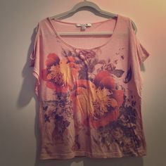 Pink floral top with cut-out shoulders Pink floral t-shirt with cut-out shoulders from Forever 21. The top is slightly sheer pink material and lightweight. In excellent condition! Forever 21 Tops Tees - Short Sleeve