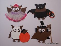 All the owl have arms thanks to the wings from the SU Bird Builder punch.   Ballerina owl has a tutu from a silk flower blossom and a crown from the Doily 3 layer SU punch and blinged with Stickles sparkly glue. Batman owl has wings made from a Cuttlebug embossed and cut bat. Ghost owl is holding his candy in a Cuttlebug pumpkin. Witchy owl has a Hero Arts (October set) broom modified by me and a hat from CTMH.