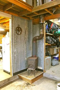 Old wood stove with galvanized roof wall protection, granite counter re-used as hearth