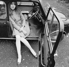 Miss Jean Shrimpton in the Morris Mini which was the hot car to have in 1965.