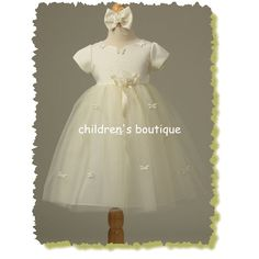 Butterfly Ribbon Infant Dress  Satin bodice and tulle skirt have delicate satin butterflies sewn on neckline and skirt. Detachable ribbon at waistband. Headband is included.