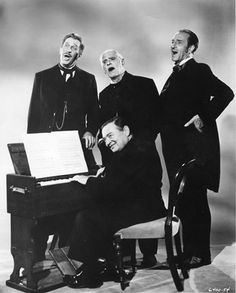 """""""The Comedy of Terrors."""" Seen here are Peter Lorre at the organ, Vincent Price, Boris Karloff and Basil Rathbone standing behind him."""