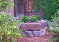 Corner lot landscaping ideas like this small curved stone for Large lot landscaping ideas