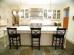 Suzie: Fabulous basement kitchen  Stone slate tiles floors, glass front white kitchen cabinets, ...