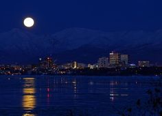 Anchorage moonrise, in a photo by Rocky Grimes.