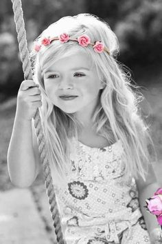 lovely little girl with wreath of pink flowers