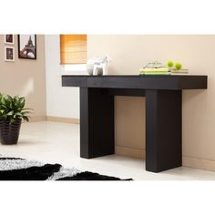 @Overstock.com - Create the perfect design to greet visitors in your entryway or to display your collectibles on in your living room with the Perry modern black sofa table. With a durable overhang tabletop on top of two pedestals, it would also make a great workspace.http://www.overstock.com/Home-Garden/Perry-Modern-Black-Finish-Sofa-Table/6234337/product.html?CID=214117 $204.99