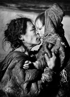 Padlei, NV Padleimuit (Innuit) Mother, haggard with hunger, with her youngest child. Photograph taken in the Arctic 1950, the year famine struck when the caribou did not come to what was then known as the North West Territories.  Richard Harrington, Canadian Photographer, Feb 1950, Padlei, Nunavut, Canada. Courtesy of Stephen Bulger Gallery.