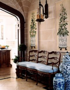 Love this bench and the blue and white urns....and the wall treatment. Wall lantern is good too.