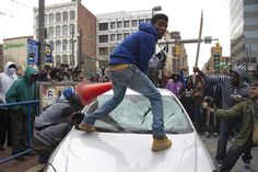 Demonstrators destroy the windshield of a Baltimore Police car as they protest the death Freddie Gray. (Photo via Jim Watson/Getty Images) Baltimore Riots, Baltimore Police, Baltimore Maryland, Pictures Of The Week, Cool Pictures, Funeral, Jim Watson, We Are The World, Fotografia