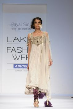 Cream Georgette Mukaish Kalidar Kurta with Crystal and Velvet Applique Embroidery worn with Purple Satin Churidaar and Tulle Mukaish Dupatta. SHOP THIS LOOK: http://www.payalsinghal.com/search/sanaa--suit