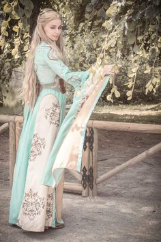 Cersei Lannister cosplay - aqua gown with birds embroideries. Completely made by me. I also tailored the underskirt and corset, style the wig and made the chainmail. For a step by step tutorial, pl...
