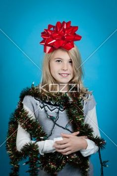 girl with bow on her head - Girl wrapped in tinsel and lights with a red bow Model: Shania Chapman - Agent is Breann at MMG.