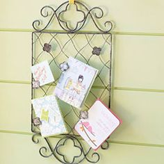 This is a pretty backdrop for special treasures you want to share in highly visible areas of your home.  A perfect match for your kitchen or family room decor and easy for kids to update thanks to the clips that secure items to the frame.