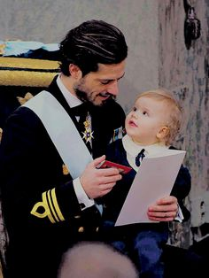 Prince Carl Philip sweetly looking at his son, Prince Alexander during Prince Gabriel's christening. || December 1st, 2017