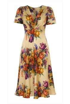 Vintage print silk tea dress based on our best selling 1930's inspired silhouette  Beautiful warm honey fluid silk satin with divine vintage inspired print.   100% silk printed in Como, Italy and individually tailor made in London.  Flattering, timeless and utterly beautiful.  A luxurious special dress for any excuisite event.   Available in sizes 8-16