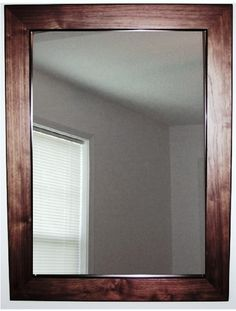 "NATURAL WALNUT WOOD FRAMED MIRROR WITH DARK STAINED OUTLINE: This framed mirror turned out just beautiful.... I tried something different with the over-all appearance of the frame by adding a darker outline on the edges. The frame is made from Dark Walnut Wood & size is 24"" x 32"" or (32"" x 24"") Hangs both ways, Dark Walnut Stain, Birch backing, Hangers are D-Rings/Clips, Quality Mirror."