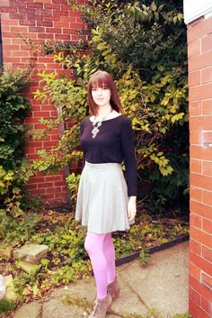 """A November outfit for 'dress UP' Friday over on my blog """"Pouting In Heels"""".  French Connection grey skirt, coloured tights, simple black long sleeved tee and statement necklace."""