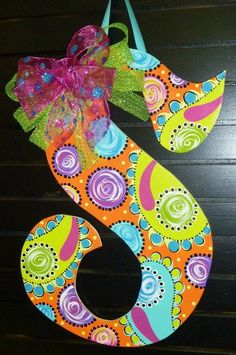 Painted wooden Initial Door Hanger with fun colorful design.