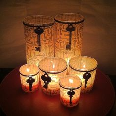 Dollar store candle holders get jazzed up with scrapbook paper and vintage keys.