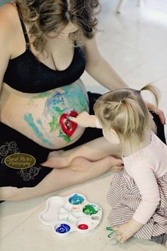 Belly Painting Maternity Photography session - I don't even like finger painting but this is soo cute!!