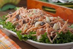 Celery and walnuts add crunch, while raisins and pineapple sweeten this vitamin-packed salad. It& a play on the famous Waldorf salad, replacing the usual apple with colorful carrots. Side Dish Recipes, Side Dishes, 70s Food, Waldorf Salad, Carrot Salad, Cooking Recipes, Healthy Recipes, Macaroni Salad, Salads