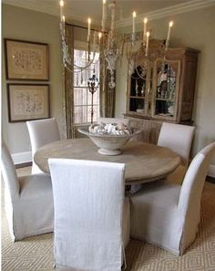 I  love the slipcovered chairs with the round table. My table is exactly like this one except it is black. I may have to get covers for my chairs.