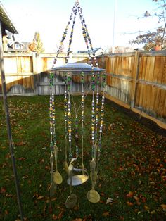 """Wind chime / re-purposed flatware and silver / red and white glass beads / garden art / """"Kaleidoscope of Color"""" This is a brand new style of wind chime we are working on. In the very center we have su"""