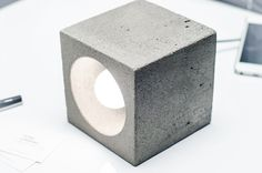 Concrete lamp with simple functional design. You can use any side as a base and set a direct light in different ways. Formed of light concrete, polished