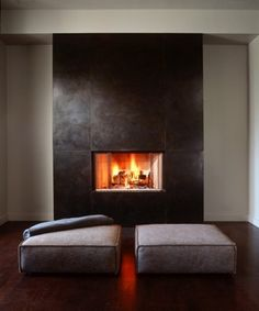 Love the use of steel on this fireplace