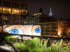 A pair of eyes on a neighboring billboard seem to watch over the High Line. Photo by Mike Tschappat
