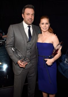 """Ben Affleck and Amy Adams, stars of the upcoming """"Batman V. Superman: Dawn of Justice,"""" cozied up backstage at the People's Choice Awards 2015. Amy presented Ben with the Choice Humanitarian Award, and he is also up for Favorite Dramatic Movie Actor for his role as Nick Dunne in """"Gone Girl."""" While Ben looked dapper in a gray suit, Amy stole the show in a strapless purple Gucci dress."""