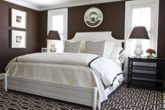 In this gorgeous dark chocolate bedroom, designer Phoebe Howard pairs a healthy dose of white against deep brown walls. The graphic pattern on the carpet and pillows is bold enough to hold up to the high contrast color scheme. Chocolate Brown Bedrooms, Chocolate Bedroom, Chocolate Brown Walls, Chocolate Color, White Chocolate, Luxury Chocolate, Dark Bedroom Walls, Home Bedroom, Bedroom Decor