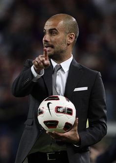 Pep Guardiola looks hot wearing a suit.