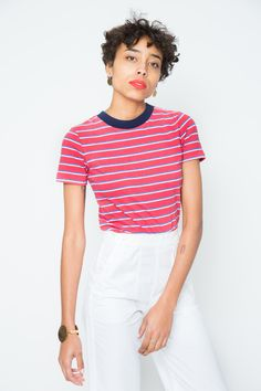 Remember that shirt your sexy skater crush wore every single day of high  school? Well, here it is but now you get to rock it. And it's fresh and  clean. Soft cotton jersey stripe with contrast crewneck. By Rolla's100%  CottonMade in China  Worn with M.I.H JEANS | Nautical Pant-White,  SOL SANA  | Blair Mule-Black Questions about this product? Email help@lisasaysgah.com