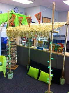 READING HUT made with bamboo poles, buckets filled with concrete, a science board and grass tables skirts. The battery operated green lights are from the Dollar Tree. Fairly easy to assemble and makes a perfect place to read in the classroom! Jungle Theme Classroom, Classroom Setting, Classroom Design, Classroom Themes, Classroom Organization, Classroom Management, Kindergarten Classroom, Kindergarten Activities, Reading Hut