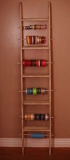 A cute way to store ribbon...now I need to find a wooden ladder.