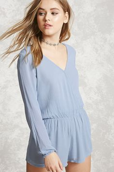 5cf6f2f84e13 Style Deals - A crinkled woven romper featuring a surplice neckline with a  snap-button